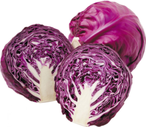 a photo of two heads of red cabbage with the front one cut in half