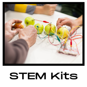 Three sets of hands on a table plugging electrodes into an apple